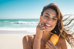 smiling woman applying SPF